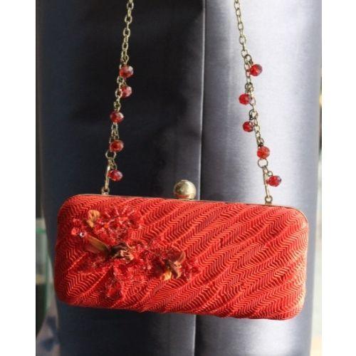 bolso rojo con pedreia y bolsas cristal 1